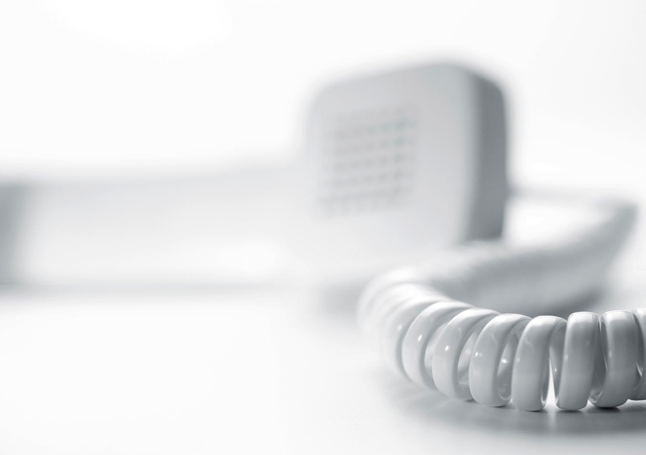 Panasonic Telefonanlage weißer Hörer liegt